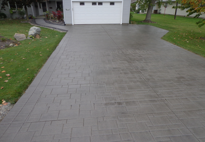 Stamped concrete driveway made to look like a pavers.