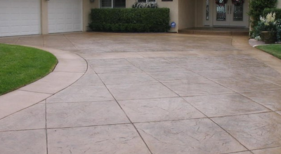Brown stained and stamped concrete driveway.
