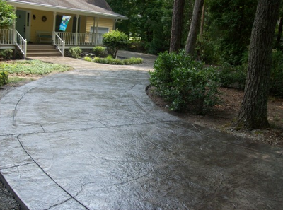 Stained and textured concrete driveway in Illinois.