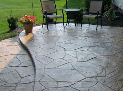 Brown stamped stone style concrete patio.