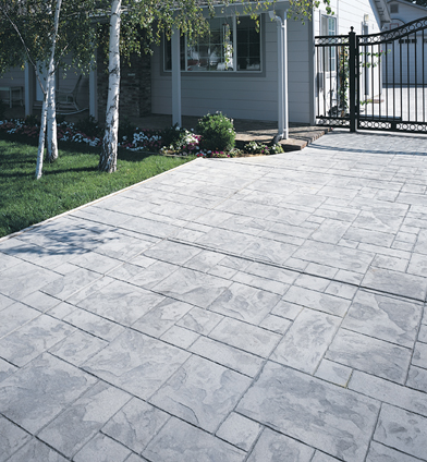 Gray stone stamped front patio in Evanston.